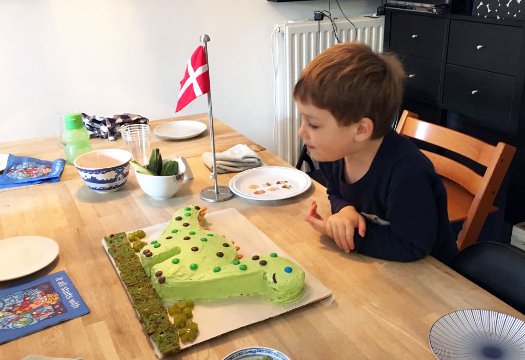 A little boy and his DINOSAUR Birthday Cake