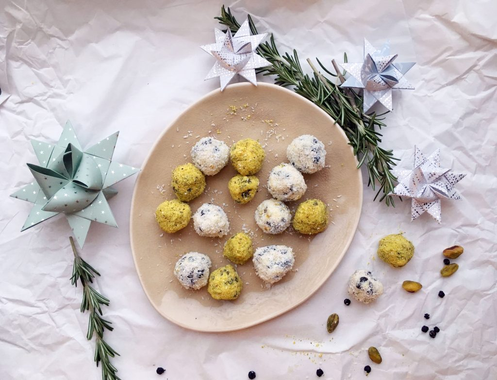 Pistachio Blueberry White Chocolate Truffles rolled in desiccated coconut and freshly ground pistachios