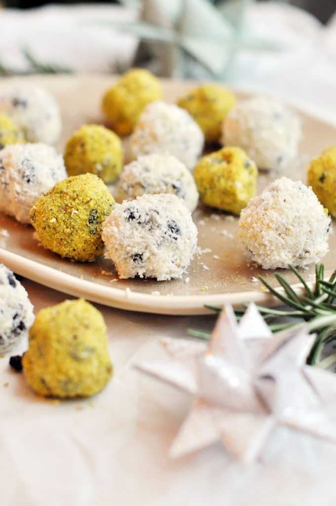 Pistachio Blueberry White Chocolate Truffles coated with desiccated coconut and freshly ground pistachios