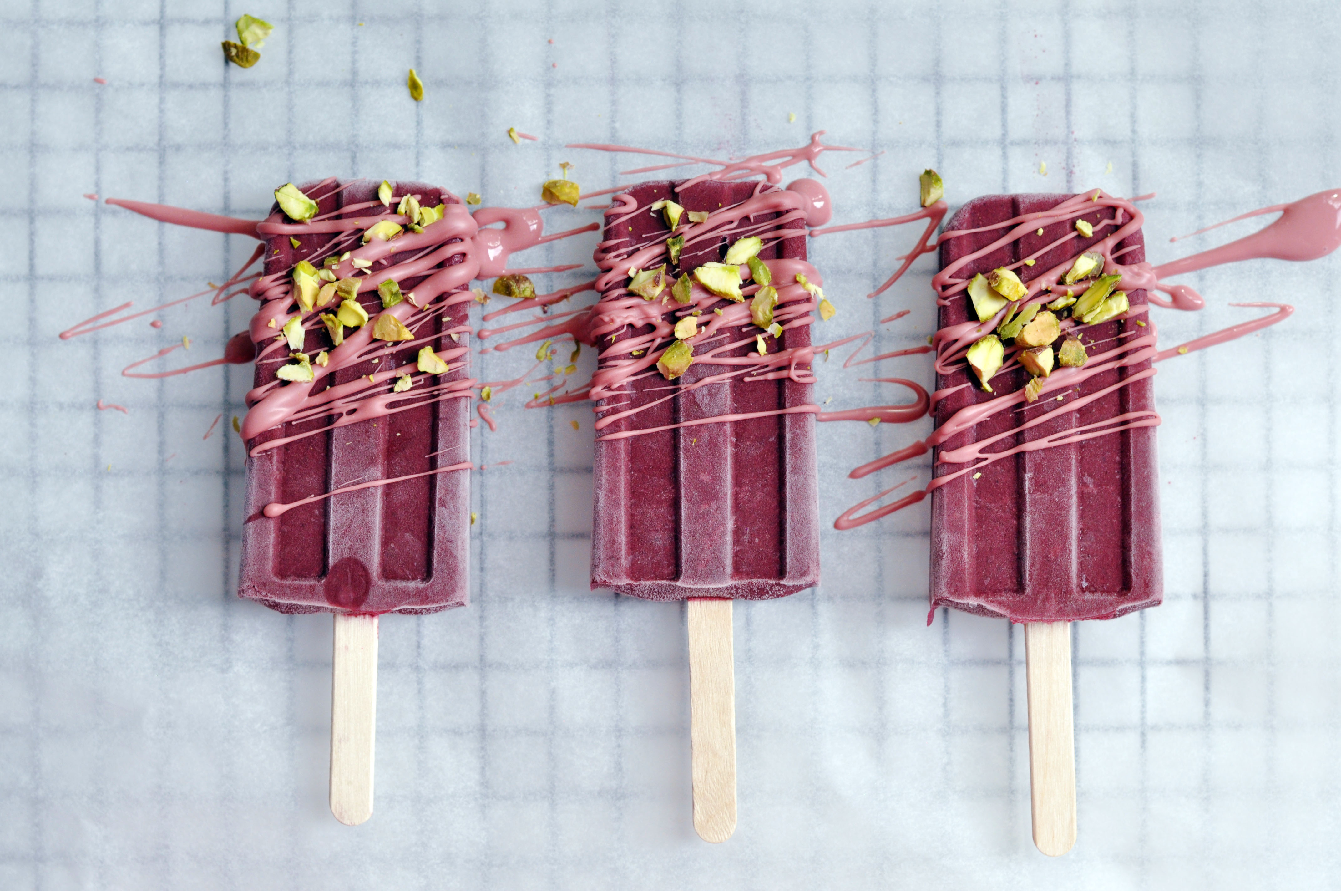 Low Histamine Blackberry Popsicle's decorated with Ruby Chocolate and pistachios