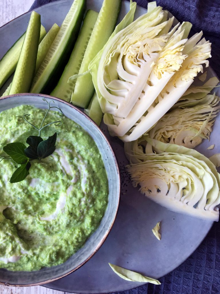 Quick and simple Pea Dip with cucumber stick and pointed white cabbage